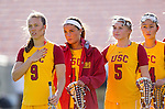 Los Angeles, CA 02/09/13 - Carley Horan (USC #9), Justina Burns (USC #5), Kelsey Davey (USC #4) and Eggy Plastaras (USC #34) stand for the national anthem before the inaugural game against Northwestern.