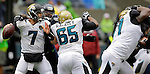 Seattle Seahawks defensive tackle Clinton McDonald (69) sacks Jacksonville Jaguars quarterback Chad Henne  (7)  at CenturyLink Field in Seattle, Washington on September 22, 2013.   Seahawks beat the Jaguars 45-17. ©2013. Jim Bryant Photo. ALL RIGHTS RESERVED.