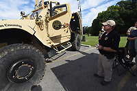 EMERGENCY GEAR ON DISPLAY<br />Deputy Michael Stockdale with the Benton County Sheriff's Office shows on Saturday Aug. 1 2020 a jumbo-sized all-terrain vehicle during an equipment exhibit by the sheriff's office and Beaver Lake Fire Department at the Dollar General store on Arkansas 12 in the Prairie Creek community. Exhibit visitors could also purchase school supplies and donate them to the sheriff's office or fire department, or both, in a friendly competition to see which agency could collect the most supplies, said Jessika Buehne (cq) with the Beaver Lake Fire Department. The sheriff's office ATV is used in swift-water rescues, special weapons and tactics responses and other emergencies, deputy Stockdale said. Go to nwaonline.com/2000802Daily/ to see more photos.<br />(NWA Democrat-Gazette/Flip Putthoff)