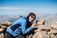 Female hiker on summit of Mount Elbert (14440 ft), Sawatch range, Colorado, USA