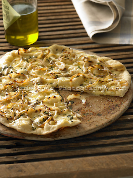 White pizza with caramelized onion, olive oil, and cheddar