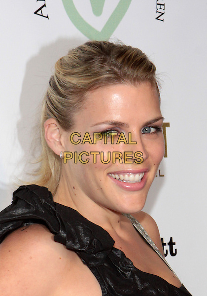 BUSY PHILLIPS .Attending the first annual LA Friend Without A Border & Angkor Hospital For Children Gala Benefit held at The  Roosevelt Hilton Hotel, Hollywood, California, USA, .10th December 2009..portrait headshot  black shoulder straps smiling .CAP/ADM/TC.©T.Conrad/Admedia/Capital Pictures