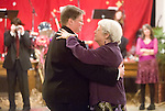"""At the March 9 ceremony, each couple received a half hour to wed in the Memorial Church's sanctuary. As each half hour neared its close, the couple and their guests were ushered into the church basement for an ongoing wedding reception, where attendees of the previous weddings awaited them. Scharf and Pickett share their """"first dance."""""""