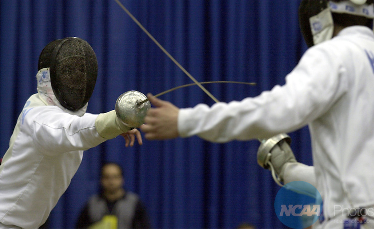 24 MAR 2002:  Soren Thompson, of Princeton, (left), battles Arpad Horvath, of St John's, (right) during the men's epee finals of the NCAA Fencing Championship held in the William E. and Carol G. Simon Forum at Drew University in Madison, NJ. Arpad Horvath, of St John's, defeated Soren Thompson, of Princeton, 15-9 for the championship. Penn State won the overall team title for the combined performances of their women and men. John Munson/NCAA Photos.