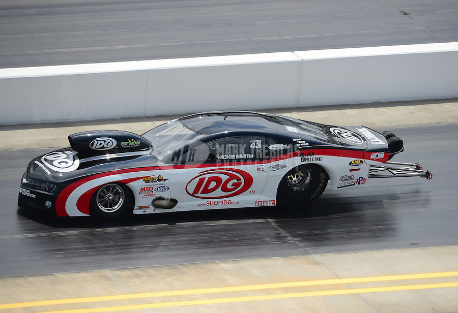 Apr. 15, 2012; Concord, NC, USA: NHRA pro mod driver Rickie Smith during the Four Wide Nationals at zMax Dragway. Mandatory Credit: Mark J. Rebilas-