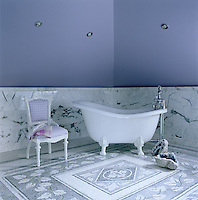In the master bathroom the lilac tone painted on the walls was matched to the color of a Bergdorf Goodman shopping bag