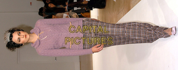 MODEL.London Fashion Week Autumn/Winter 2005/6 at the Royal Academy of Arts..Ronit Zilkha Fashion Show .February 13th 2005.full length catwalk pink sweater tweed trousers.www.capitalpictures.com.sales@capitalpictures.com.©Capital Pictures