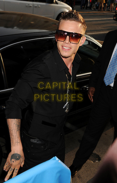 Chris Rene.'The X Factor' Season 2 Premiere Party at Grauman's Chinese Theatre, Hollywood, California, USA..11th September 2012.half length sunglasses shades black shirt  tattoos .CAP/ROT/TM.© TM/Roth/Capital Pictures