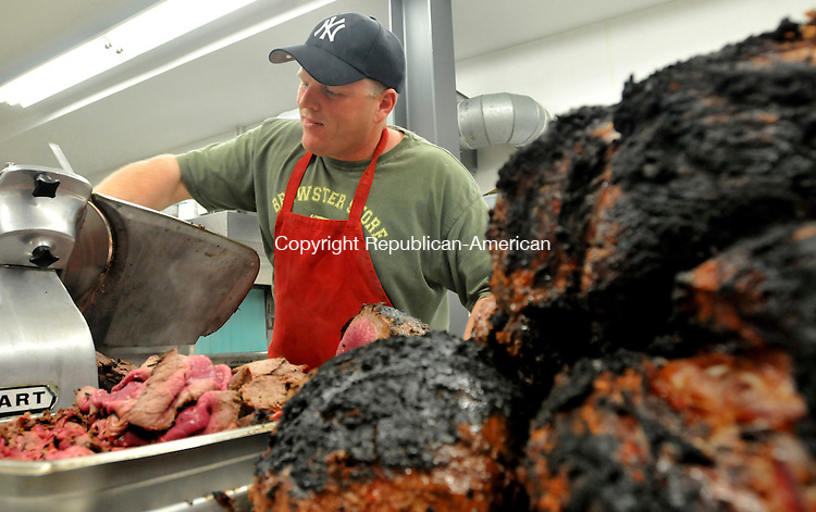 LITCHFILED, CT-10 MAY 2009 --051009JS12--FOR COUNTRY LIFE- Darren Lounsbury, a volunteer firefighter with the Bantam Fire Company slices roast beef for guests during the company's roast beef dinner held Saturday at the Bantam Firehouse.  <br /> Jim Shannon Republican-American