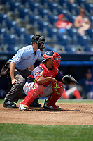 Portland Sea Dogs catcher Jhon Nunez (20) ready to receive a pitch in front of home plate umpire Derek Gonzales during the second game of a doubleheader against the Reading Fightin Phils on May 15, 2018 at FirstEnergy Stadium in Reading, Pennsylvania.  Reading defeated Portland 9-8.  (Mike Janes/Four Seam Images)