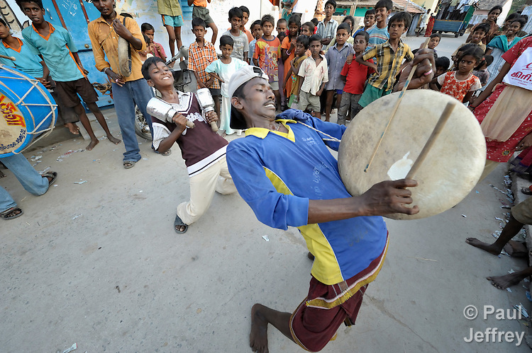 Youth play drums to invite residents of Sathangudi, a rural village outside of Madurai, in the southern Indian state of Tamil Nadu, to a play about HIV and AIDS. The group is sponsored by the Center for Research and Rehabilitation of Infants and Females (CRIF), which conducts advocacy and education on HIV and AIDS. CRIF receives support from United Methodist Women Mission Giving.