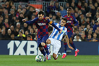 7th March 2020; Camp Nou, Barcelona, Catalonia, Spain; La Liga Football, Barcelona versus Real Sociedad;  Leo Messi is dragged back from behind as he powers towards goal