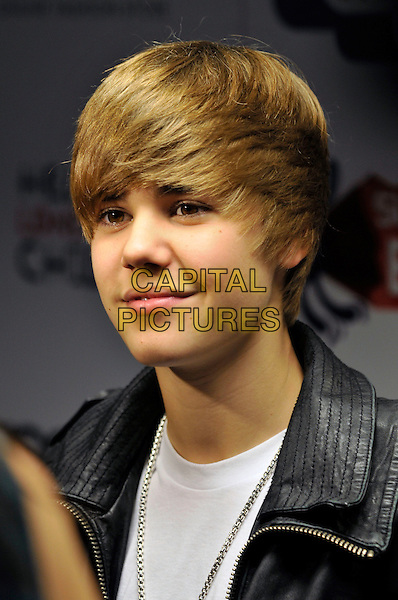 JUSTIN BIEBER.Capital FM Summertime Ball at Wembley Stadium, London, England, UK..June 6th 2010.headshot portrait white black leather.CAP/PL.©Phil Loftus/Capital Pictures.