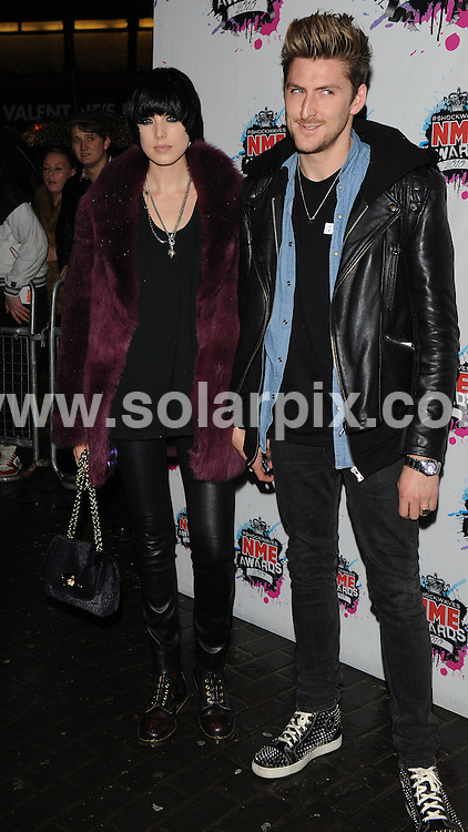 **ALL ROUND PICTURES FROM SOLARPIX.COM**.**WORLDWIDE SYNDICATION RIGHTS**.Outside arrivals at the Shockwaves NME Awards 2010, held at the Carling Brixton Academy, London, UK. 24 February 2010.This pic: Agyness Deyn and Henry Holland..JOB REF: 10788 SSD     DATE: 24_10_2010.**MUST CREDIT SOLARPIX.COM OR DOUBLE FEE WILL BE CHARGED**.**MUST NOTIFY SOLARPIX OF ONLINE USAGE**.**CALL US ON: +34 952 811 768 or LOW RATE FROM UK 0844 617 7637**