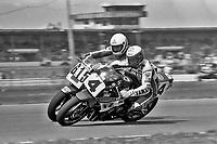 Eddie Lawson, #4 Yamaha, passes Steve Parrish, #615 Yamaha, Daytona 200, AMA Superbikes, Daytona International Speedway, Daytona Beach, FL, March 9, 1986.(Photo by Brian Cleary/bcpix.com)