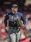 6 April 2014: Atlanta Braves first baseman Freddie Freeman trots back to the dugout during a game against the Washington Nationals at Nationals Park in Washington, DC. The Nationals defeated the Braves 2-1 to salvage the last game of their 3-game series. Mandatory Credit: Ed Wolfstein Photo *** RAW (NEF) Image File Available ***