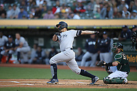 OAKLAND, CA - AUGUST 20:  Gary Sanchez #24 of the New York Yankees hits a home run against the Oakland Athletics during the game at the Oakland Coliseum on Tuesday, August 20, 2019 in Oakland, California. (Photo by Brad Mangin)