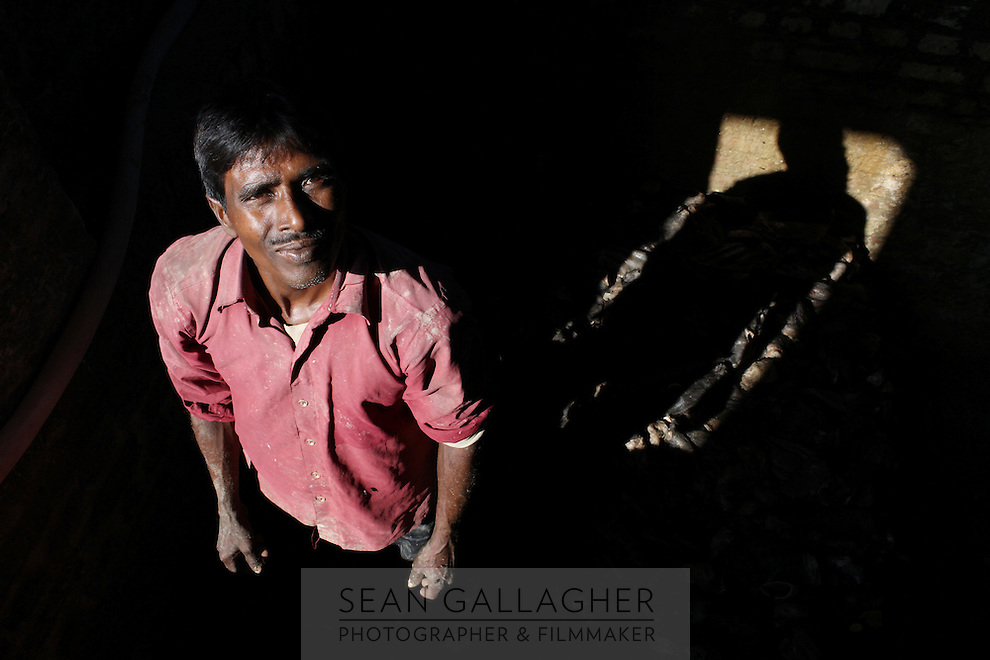 A worker stands inside one of the many small, informal tanneries that operate in the Jajmau area of Kanpur.