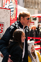 ESPN analyst and former men's national team defender Alexi Lalas poses for a photo with fans during the centennial celebration of U. S. Soccer at Times Square in New York, NY, on April 04, 2013.