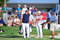 Phil Mickelson (USA) and Kevin Kisner (USA) wait to head to the 15th tee during round 2 Four-Ball of the 2017 President's Cup, Liberty National Golf Club, Jersey City, New Jersey, USA. 9/29/2017.<br /> Picture: Golffile | Ken Murray<br /> <br /> All photo usage must carry mandatory copyright credit (&copy; Golffile | Ken Murray)