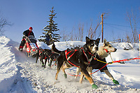 Ramy Brooks team mushes out of McGrath Chkpt onto Kuskokwim River 2006 Iditarod Interior AK Winter