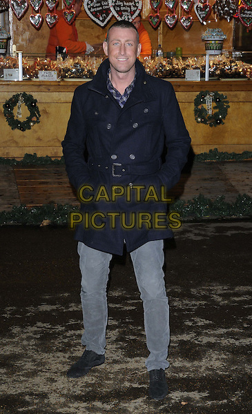 Christopher Maloney.attended the Hyde Park Winter Wonderland launch party, Hyde Park, London, England, UK, .22nd November 2012..full length x factor grey gray jeans blue navy coat belt black .CAP/CAN.©Can Nguyen/Capital Pictures.
