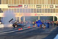 May 18, 2014; Commerce, GA, USA; NHRA top fuel driver Bob Vandergriff Jr (left) loses control and goes on two wheels alongside Clay Millican during the Southern Nationals at Atlanta Dragway. Mandatory Credit: Mark J. Rebilas-USA TODAY Sports
