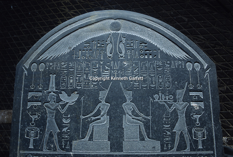 Detail of stela of Nectanebo I making offerings to the god, Late Period; A stela with text recording a royal decree stating that a tenth of the taxes collected on imported goods should be donated to the temple of the goddess Neith in Sais