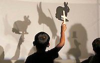 NWA Democrat-Gazette/DAVID GOTTSCHALK  Shadows are cast by second grade students, from Parson Hills Elementary School in Springdale, from  shadow puppets Thursday, November 5, 2015, at the Community Creative Center at the Walton Arts Center's Nadine Baum Studios in Fayetteville. Two second grade classes from the school participated in the Stage to Studio program, sponsored by the Windgate Charitable Foundation, Mondelez International and Einstein Bros. Bagels, were the students watched a performance of Me and My Shadow at the Walton Arts Center and then created the shadow puppets at the studios.
