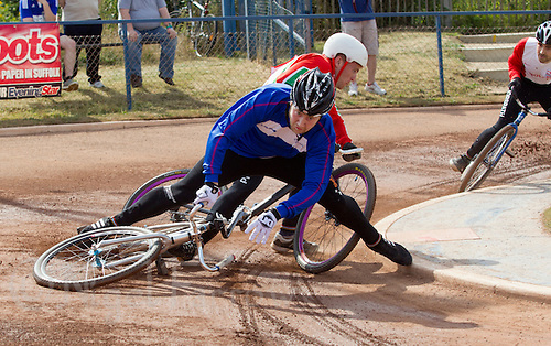 11 JUL 2015 - IPSWICH, GBR - Mikey Hewitson (SCO) (left) of Scotland and Jack Harrold (WAL) of Wales crash during the cycle speedway Home International at Whitton Sports and Community Centre in Ipswich, Suffolk, Great Britain (PHOTO COPYRIGHT © 2015 NIGEL FARROW, ALL RIGHTS RESERVED)