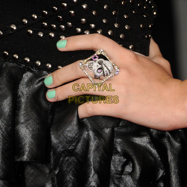 "DEMI LOVATO .""Hannah Montana: The Movie"" Los Angeles Premiere held at the El Capitan Theatre, Hollywood, CA, USA, .2nd April 2009. .detail hand ring skull diamante  nails nail varnish green.CAP/ADM/BP.©Byron Purvis/Admedia/Capital PIctures"