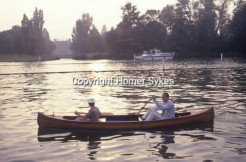 Couple Henely on Thames. Oxfordshire UK . Romantic couple in rowing boat together.