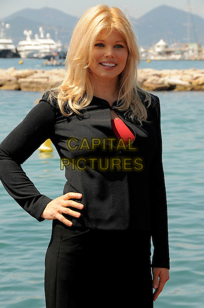 "DONNA D'ERRICO.Photocall for ""The Making of Plus One"" at the Majestic Hotel during the 62nd Annual Cannes Film Festival, Cannes, France..May 16th, 2009.half length black dress hand on hip .CAP/CAS.©Bob Cass/Capital Pictures."