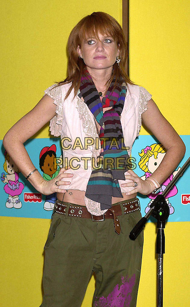 PATSY PALMER.Announces The Winner of the Fisher-Price Little People, The Next Kate Moss Competition. Overall Winner Phoebe McCallan..Centry Club, London..fashion disaster, striped scarf, stripey, stripes, hans on hips, half length, half-length.www.capitalpictures.com.sales@capitalpictures.com.© Capital Pictures