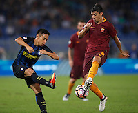 Calcio, Serie A: Roma vs Inter. Roma, stadio Olimpico, 2 ottobre 2016.<br /> FC Inter&rsquo;s Yuto Nagatomo, left, and Roma&rsquo;s Diego Perotti fight for the ball during the Italian Serie A football match between Roma and FC Inter at Rome's Olympic stadium, 2 October 2016.<br /> UPDATE IMAGES PRESS/Isabella Bonotto