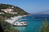 Greece, Corfu, Nisaki (Nissaki): Nissaki Beach Hotel above beach with excursion boat