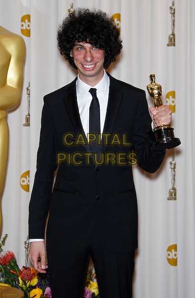 LUKE MATHENY.Best Short Film (Live Action).83rd Annual Academy Awards - Oscars.Kodak Theatre, Hollywood, CA, USA..February 27th, 2011 .press room pressroom winner trophy half length black suit .CAP/PE.©Peter Eden/Capital Pictures.