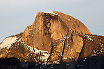 """Half Dome Sunset 3"" Yosemite National Park, California. I have posted a series of three photographs of this sunset along with an artistic version where I smoothed out the texture of the rock. This photograph was taken a few minutes before the ""Sunset 2"" image. Capturing Half Dome at sunset really showcases the spectacular colors of its monolithic face.  45,000 people a year climb the famous cables to the summit. I took this picture on my way back down from hiking Yosemite Falls Waterfall."