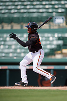 GCL Orioles center fielder Markel Jones (30) follows through on a swing during the first game of a doubleheader against the GCL Twins on August 1, 2018 at CenturyLink Sports Complex Fields in Fort Myers, Florida.  GCL Twins defeated GCL Orioles 7-6 in the completion of a suspended game originally started on July 31st, 2018.  (Mike Janes/Four Seam Images)