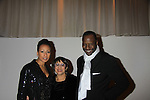 """As The World Turns; Law and Order SVU Tamara Tunie poses with mom GG and husband Gregory Generet at Hearts of Gold's 16th Annual Fall Fundraising Gala & Fashion Show """"Come to the Cabaret"""", a benefit gala for Hearts of Gold on November 16, 2012 at the Metropolitan Pavilion, New York City, New York.   (Photo by Sue Coflin/Max Photos)"""