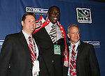 12 January 2007: Bakary Soumare (center) was selected by the Chicago Fire with the #2 overall pick. He is flanked by General Manager and president John Guppy (l) and head coach Dave Sarachan (r). The 2007 MLS SuperDraft was held in the Indianapolis Convention Center in Indianapolis, Indiana during the National Soccer Coaches Association of America's annual convention.