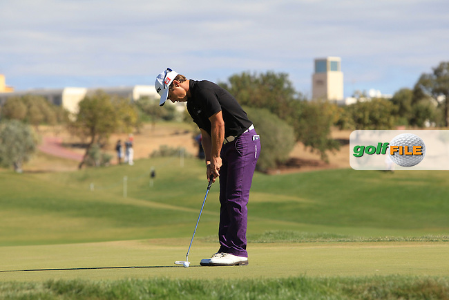 Thorbjorn Olesen (DEN) putts on the 1st green during Saturday's Round 3 of the Portugal Masters at the Oceanico Victoria Golf Course, Vilamoura, Portugal 13th October 2012 (Photo Eoin Clarke/www.golffile.ie)