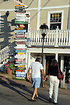 People cross street with signs Kennebunkport Maine, New England region of northeatern United States, boardered by Atlantic Ocean to the east and south, Maine is the northermost and easternmorst portion of New England, jagged rocky coastline, rolling mountains, heavily forested interior picturesque waterways, seafood cuisine, lobster and clams, European settlement in Maine was 1604, 23rd state March 15 1820, Dirigo, Maine is The Pine Tree State, Maine Stock and Fine Art Photography.  All Rights Reserved RonBennettPhotography.com All Photographs for SALE.