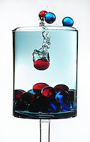 Glass marbles splashing in water