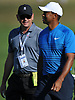 Rob McNamara, player manager, left, paces alongside Tiger Woods during a practice round prior to the U.S. Open Championship at Shinnecock Hills Golf Club in Southampton on Tuesday, June 12, 2018.