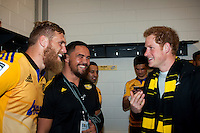 Prince Harry mingles with the Hurricanes team, including Brad Shields (left) and Mike Kainga (2nd left) in the Hurricanes changing rooms after the Super Rugby match between the Hurricanes and Sharks at Westpac Stadium, Wellington, New Zealand on Saturday, 9 May 2015. Photo: Dave Lintott / lintottphoto.co.nz