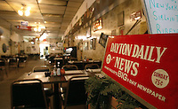 A Dayton Daily News sign sits at the entrance of &quot;The Varsity Club&quot; restaurant Thursday June 5, 2003 in Kenton, Ohio.<br />