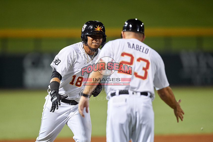 Mesa Solar Sox Isaac Paredes (18), of the Oakland Athletics organization, is congratulated by manager Mike Rabelo (23) as he rounds third base after hitting a two-run home run during an Arizona Fall League game against the Peoria Javelinas on September 21, 2019 at Sloan Park in Mesa, Arizona. (Zachary Lucy/Four Seam Images)
