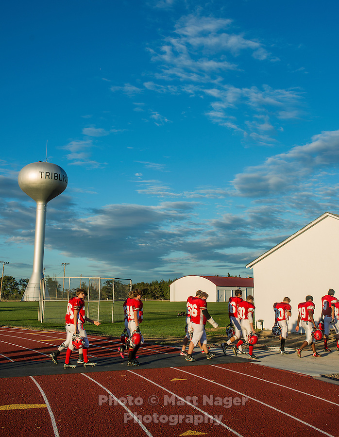 The Greeley County High School football team, the Tribune Jackrabbits, prepare for an eight man football game in Tribune, Kansas, Friday, October 13, 2013. The challenges of depopulation in the rural Midwest and Great Plains continue to grow as counties increasingly see more deaths than births. Greeley County, Kansas's least populated county, and the state as a whole are mounting a new fight to stem losses and finding early success. <br /> <br /> Photo by Matt Nager