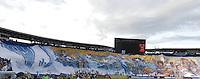 BOGOTA - COLOMBIA -26 -07-2015: Hinchas de Millonarios extienden una bandera de su equipo durante el encuentro entre Millonarios y Once Caldas por la fecha 3 de la  Liga Águila II 2015 jugado en el estadio Nemesio Camacho El Campín de la ciudad de Bogotá./ Fans of Millonarios tend a flag of their team during the match between Millonarios and Once Caldas for the third date of the Aguila League II 2015 played at Nemesio Camacho El Campin stadium in Bogotá city. Photo: VizzorImage / Gabriel Aponte / Staff.